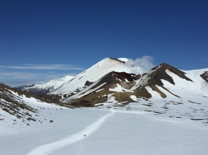 Looking back at the long snowfield from the Emerald Lakes