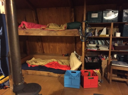 Our beds near the tiny wood stove