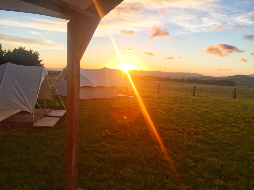 Adjacent smaller tents at sunrise